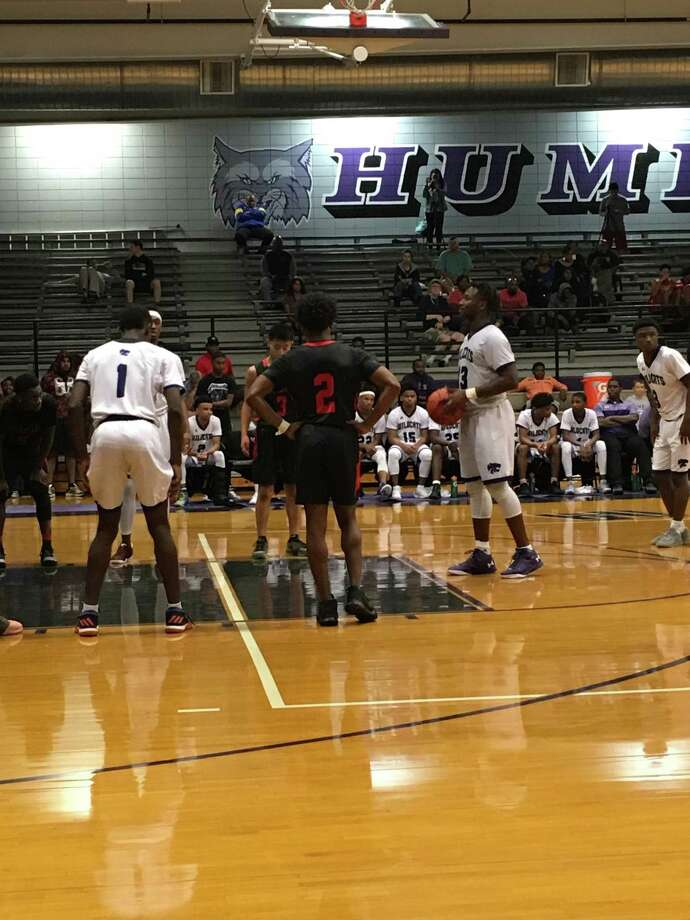 Junior Justin Lawson shoots free throws in the fourth quarter. Lawson had 32 points and nine rebounds in the Humble Wildcat's' 71-62 victory over Clear Brook Tuesday night at Humble High School in the first game of the season. Photo: Elliott Lapin