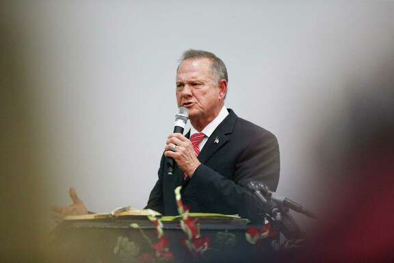 Former Alabama Chief Justice and U.S. Senate candidate Roy Moore speaks Tuesday at a revival Tuesday in Jackson, Ala.