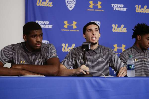 Flanked by teammates Cody Riley, left, and Jalen Hill, UCLA basketball player LiAngelo Ball reads his statement during a news conference at UCLA Wednesday, Nov. 15, 2017, in Los Angeles. The three players were detained in Hangzhou following allegations of shoplifting last week before a game against Georgia Tech in Shanghai. (AP Photo/Jae C. Hong)