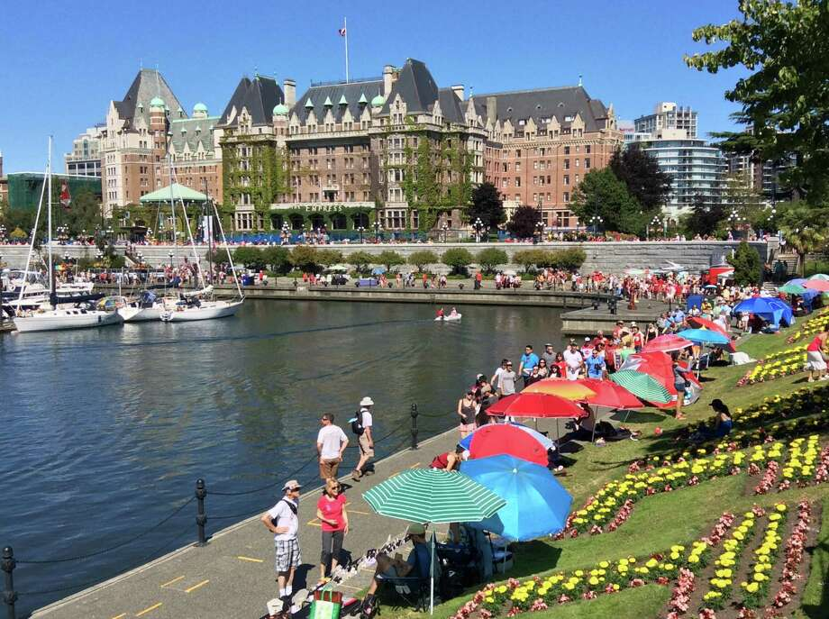 The magnificent Fairmont Empress Hotel takes center stage and is a hub of activity in Victoria's Inner Harbour. Photo: Michelle Newman / For The Express-News