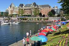 The magnificent Fairmont Empress Hotel takes center stage and is a hub of activity in Victoria's Inner Harbour.