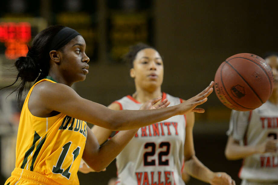 Midland College's Alexandrea Washington (11) passes against Trinity Valley in the second round of the Women's National Invitational Tournament on Friday, Nov. 18, 2016, at Chaparral Center.