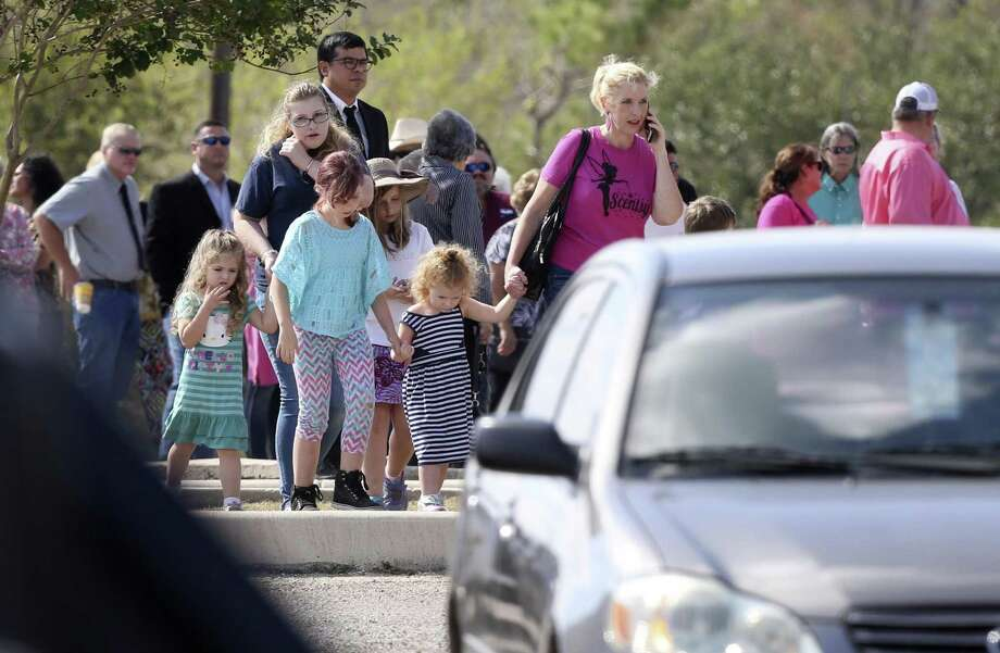 Mourners make their way to the Floresville Event Center to remember nine Holcombe and Hill family members as well as close family friend Tara McNulty, who were among 26 people killed in the Nov. 5 shooting at First Baptist Church of Sutherland Springs. Photo: William Luther / San Antonio Express-News / © 2017 San Antonio Express-News