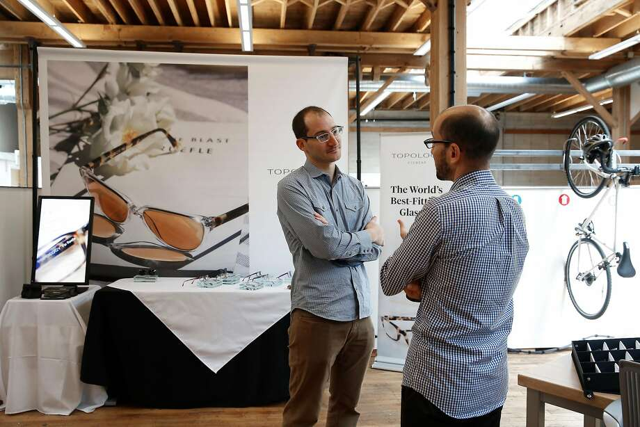 Topology Eyewear founder Eric Varady (above left) talks with his brother and COO Rob Varady at their S.F. production facility. Photo: Liz Hafalia, The Chronicle