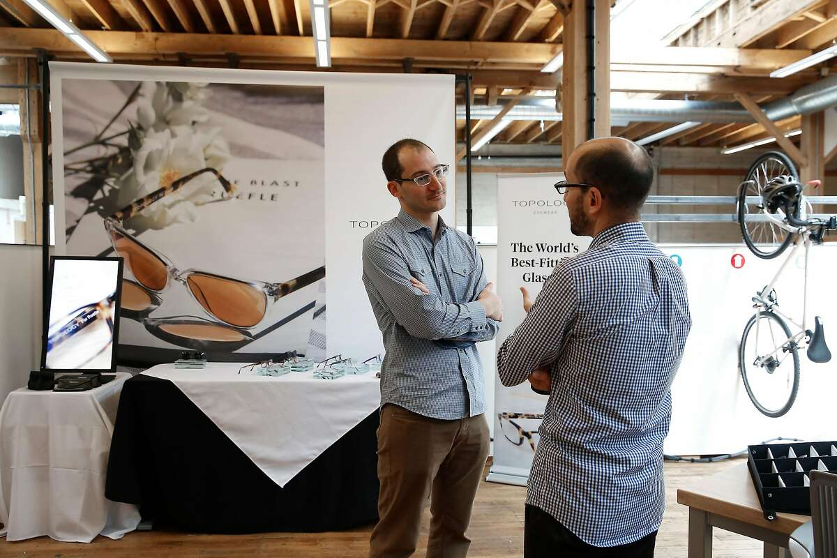 Founder and CEO Eric Varady (left) talks with his brother and COO Rob Varady (right) at the Topology production facility on Thursday, September 28, 2017, in San Francisco, Calif.
