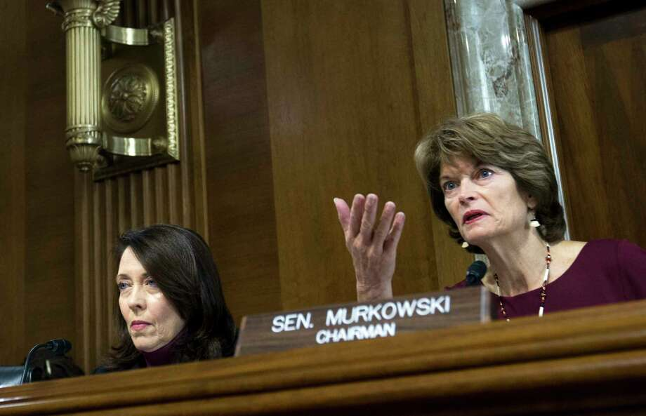 Senate Energy and Natural Resources Committee Chair Sen. Lisa Murkowski, R-Alaska, right, speaks as committee's ranking member Sen. Maria Cantwell, D-Wash., looks on, during a hearing on Capitol Hill in Washington, Wednesday, Nov. 15, 2017. Oil and gas drilling in Alaska's Arctic National Wildlife Refuge moved closer Wednesday as a key Senate panel approved a bill to open the remote refuge to energy exploration. The Senate Energy and Natural Resources Committee approved the drilling measure, 13-10.   ( AP Photo/Jose Luis Magana) Photo: Jose Luis Magana, FRE / FR159526 AP