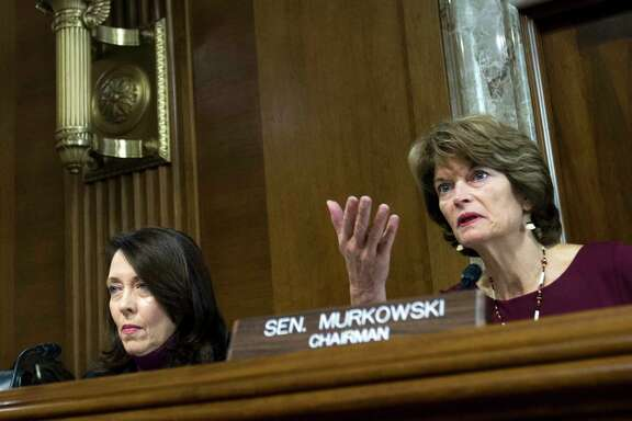 Senate Energy and Natural Resources Committee Chair Sen. Lisa Murkowski, R-Alaska, right, speaks as committee's ranking member Sen. Maria Cantwell, D-Wash., looks on, during a hearing on Capitol Hill in Washington, Wednesday, Nov. 15, 2017. Oil and gas drilling in Alaska's Arctic National Wildlife Refuge moved closer Wednesday as a key Senate panel approved a bill to open the remote refuge to energy exploration. The Senate Energy and Natural Resources Committee approved the drilling measure, 13-10.   ( AP Photo/Jose Luis Magana)