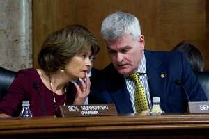Senate Energy and Natural Resources Committee Chair Sen. Lisa Murkowski, R-Alaska, speaks with Sen. Bill Cassidy, R-La. during the Energy and Natural Resources Committee hearing on Capitol Hill in Washington, Wednesday, Nov. 15, 2017. ( AP Photo/Jose Luis Magana)