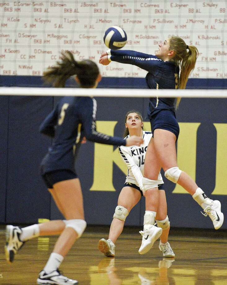 King's Ruby Bienen (5) and Stephanie Costabile (14) watch as Ava Robinowitz (3) gets under a return in a NEPSAC girls volleyball quarter final game against Miss Hall's at King School in Stamford, Connecticut on Tuesday, Nov. 15, 2017. King swept Miss Hall's 3-0 ( 25-13, 25-11, 25-16 ) to advance to Saturday's semi final against Greens Farms Academy. Photo: Matthew Brown / Hearst Connecticut Media / Stamford Advocate