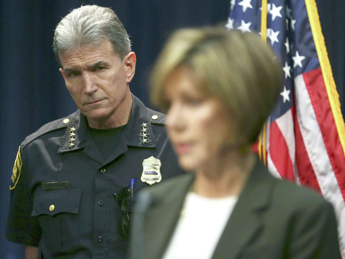 San Antonio Police Chief William McManus watches as City Manager Sheryl Sculley explains during a news conference in October 2017 that the city is investigating the apparent mishandling of at least 130 cases by a detective in the Special Victims Unit. That detective, Kenneth Valdez, was later fired. He is appealing.