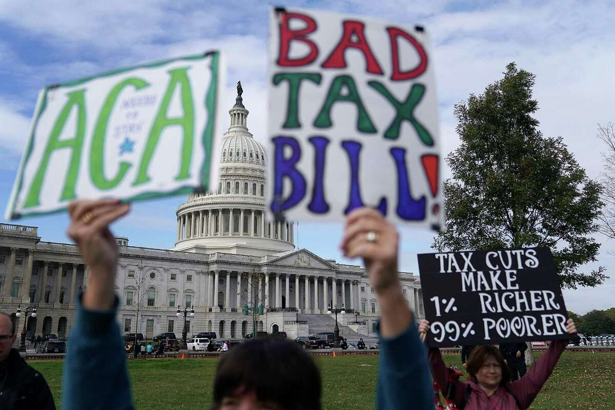 Demonstrators join a rally organized by liberal groups against the proposed tax reform legislation at the U.S. Capitol on Wednesday.