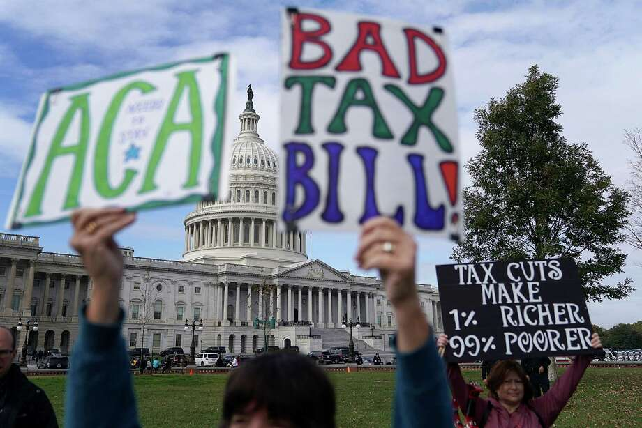 Demonstrators join a rally organized by liberal groups against the proposed tax reform legislation at the U.S. Capitol on Wednesday. Photo: Chip Somodevilla, Staff / 2017 Getty Images