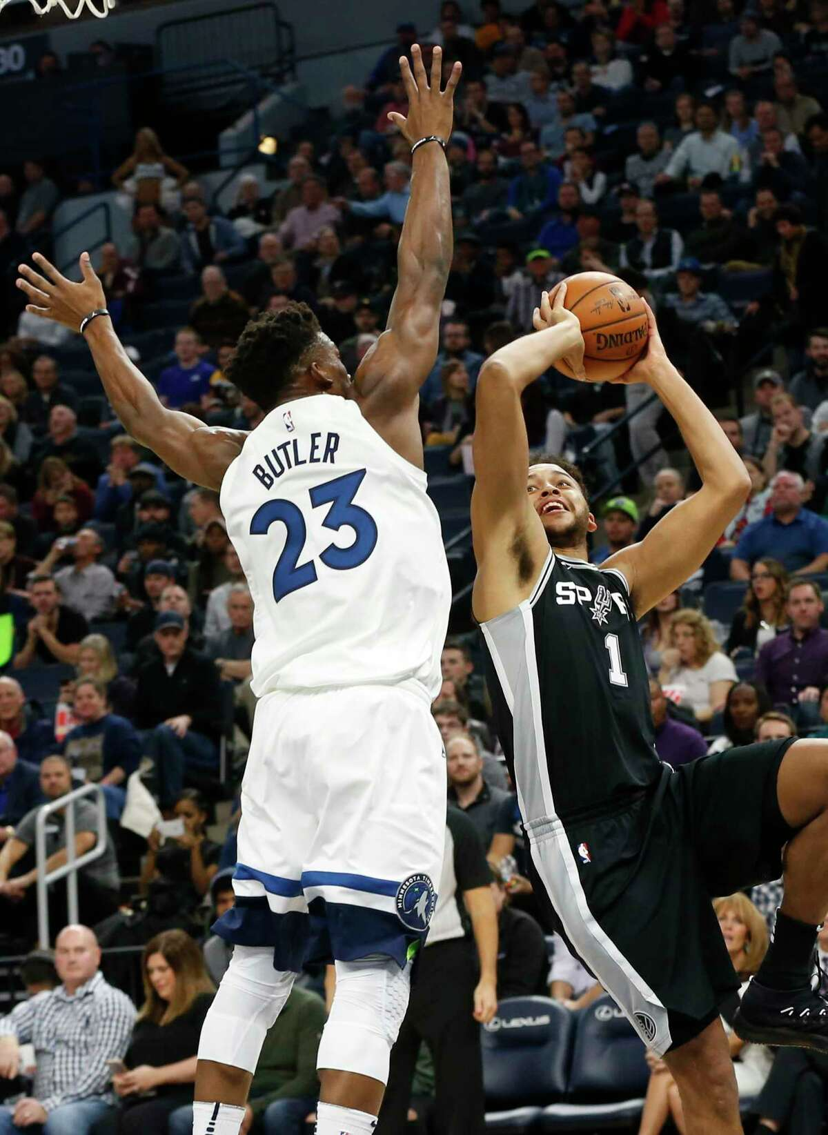 San Antonio Spurs' Kyle Anderson, right, shoots as Minnesota Timberwolves' Jimmy Butler defends in the first half of an NBA basketball game Wednesday, Nov. 15, 2017 in Minneapolis. (AP Photo/Jim Mone)
