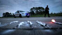 """A sheriff walks near a roadblock after a chemical plant operated by Arkema had an explosion during the aftermath of Hurricane Harvey in Crosby in this Aug. 31 photo. """"Our message is you do have to reassess your worst-case scenario,"""" U.S. Chemical Safety Board Chairwoman Vanessa Allen Sutherland said Wednesday."""