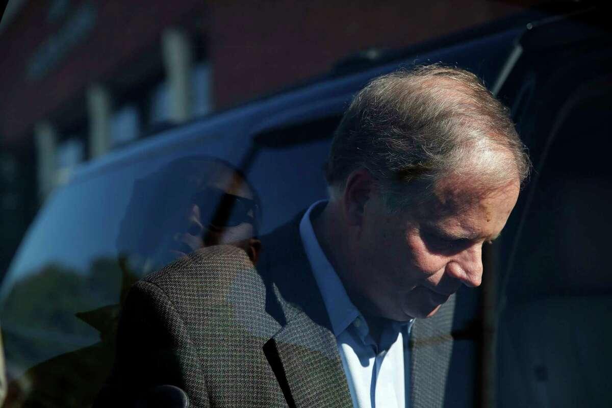 Alabama Democrat Senate candidate Doug Jones gets into his car after speaking to the media, Tuesday, Nov. 14, 2017, in Birmingham, Ala. Jones runs against former judge Roy Moore. (AP Photo/Brynn Anderson)