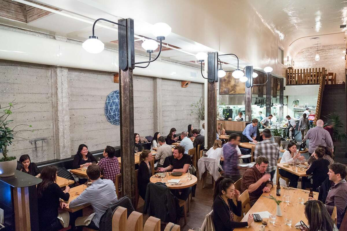 Diners eat in the main space at The Progress restaurant in San Francisco, Calif., Wednesday, February 4, 2015.