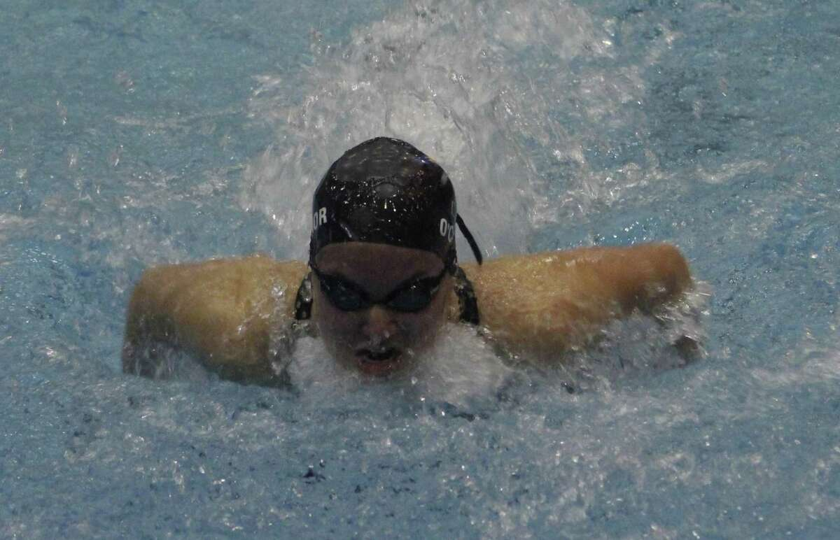 Brookfield's Madeline O'Connor swims the 200-yard individual medley during the Class M state swimming championships at Southern Connecticut State University in New Haven Nov. 15, 2017.