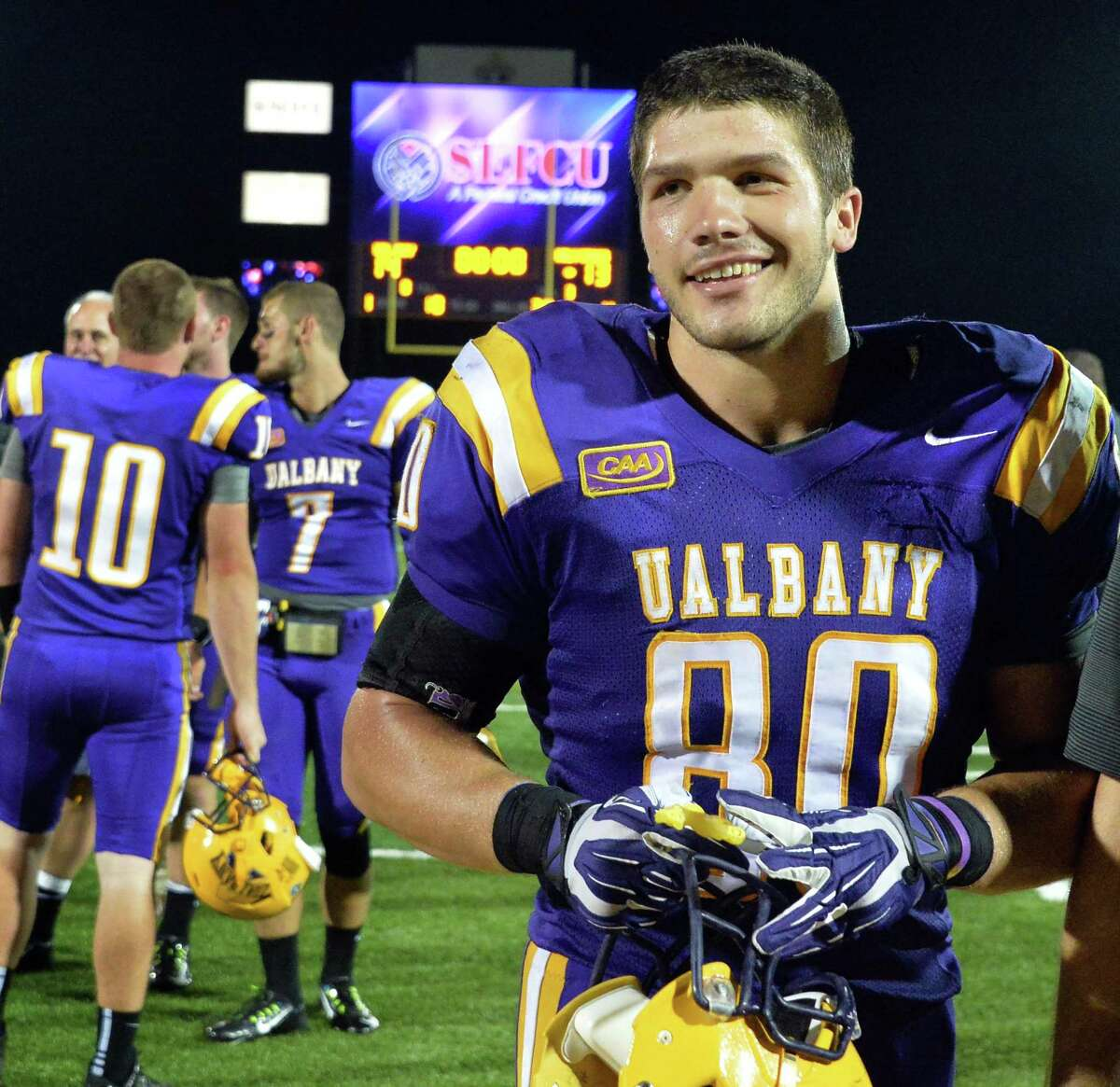 UAlbany's #80 Brian Parker is all smiles as he leaves the field after Saturday's season opener win against Holy Cross at Bob Ford Field in Albany, NY. (John Carl D'Annibale / Times Union)