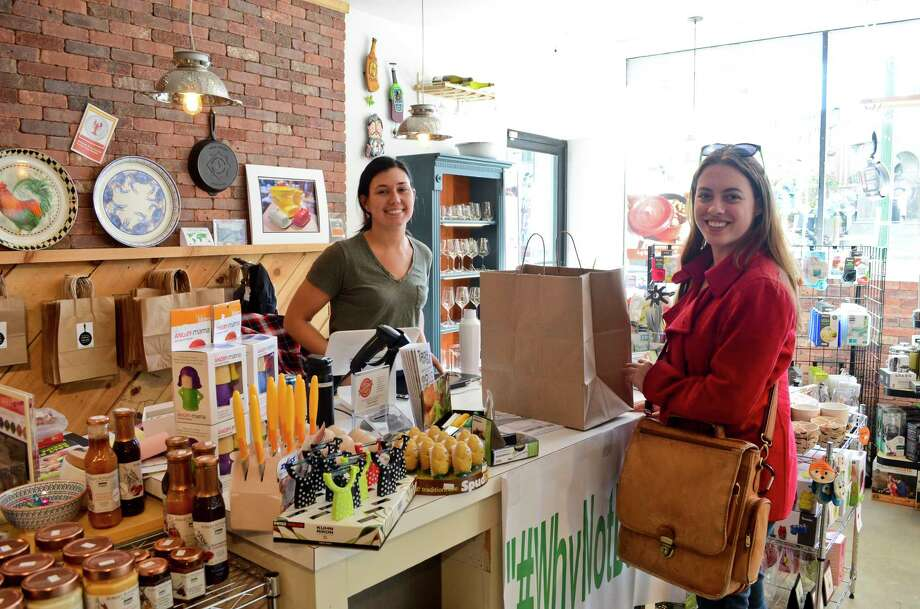 Sara Tracey, Senior Editor of UPSTATE magazine, attempts to do all of her holiday shopping locally in the Capital Region, in one day, using public transportation on Friday, October 27, 2017. Tracey speaks with the coowner of Culinary Square in Troy, where she finds a gift for one of the people on her list. (Photo by Colleen Ingerto / Times Union) Photo: Colleen Ingerto / Times Union