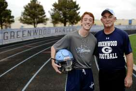 Greenwood football assistant coach Pat Liles and his son Brett Liles in portrait Nov. 5, 2017.  James Durbin/Reporter-Telegram