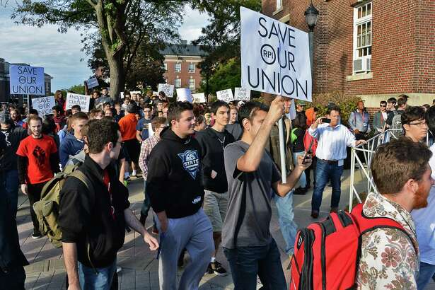 Student protesters push past a barricade and stream out into campus as they demonstrate against the RPI administration for not respecting their free-speech right Friday Oct. 13, 2017 in Troy, NY.  (John Carl D'Annibale / Times Union)
