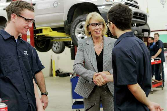U.S. Secretary of Education Betsy DeVos shakes hands with students during a school visit at Summer Creek High School on Wednesday, Nov. 15, 2017.
