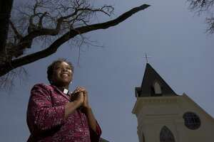 Portrait of Rev. Salatheia Bryant-Honors, a co-pastor with her husband outside the Reedy Chapel an African Methodist Episcopal church Wednesday, Aug. 12, 2009, in Galveston.  Reedy Chapel was the first African Methodist Episcopal church in Texas that started as a church for black slaves in 1848. The chapel, devastated after Hurricane Ike, is now reopen after 315 days of renovation and will hold a rededication ceremony Aug. 30. ( Johnny Hanson / Chronicle )