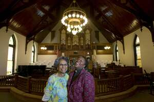 Portrait of Rev. Salatheia Bryant-Honors, (right) a co-pastor at the Reedy Chapel with fourth generation parishioner, Florence Henderson, 85, (left) in the newly restored African Methodist Episcopal church Wednesday, Aug. 12, 2009, in Galveston.  Reedy Chapel was the first African Methodist Episcopal church in Texas that started as a church for black slaves in 1848. The chapel, devastated after Hurricane Ike, is now reopen after 315 days of renovation and will hold a rededication ceremony Aug. 30. ( Johnny Hanson / Chronicle )
