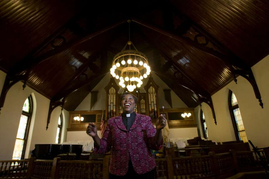 Portrait of Rev. Salatheia Bryant-Honors, a co-pastor with her husband inside the Reedy Chapel an African Methodist Episcopal church Wednesday, Aug. 12, 2009, in Galveston.  Reedy Chapel was the first African Methodist Episcopal church in Texas that started as a church for black slaves in 1848. The chapel, devastated after Hurricane Ike, is now reopen after 315 days of renovation and will hold a rededication ceremony Aug. 30. ( Johnny Hanson / Chronicle ) Photo: Johnny Hanson/Chronicle