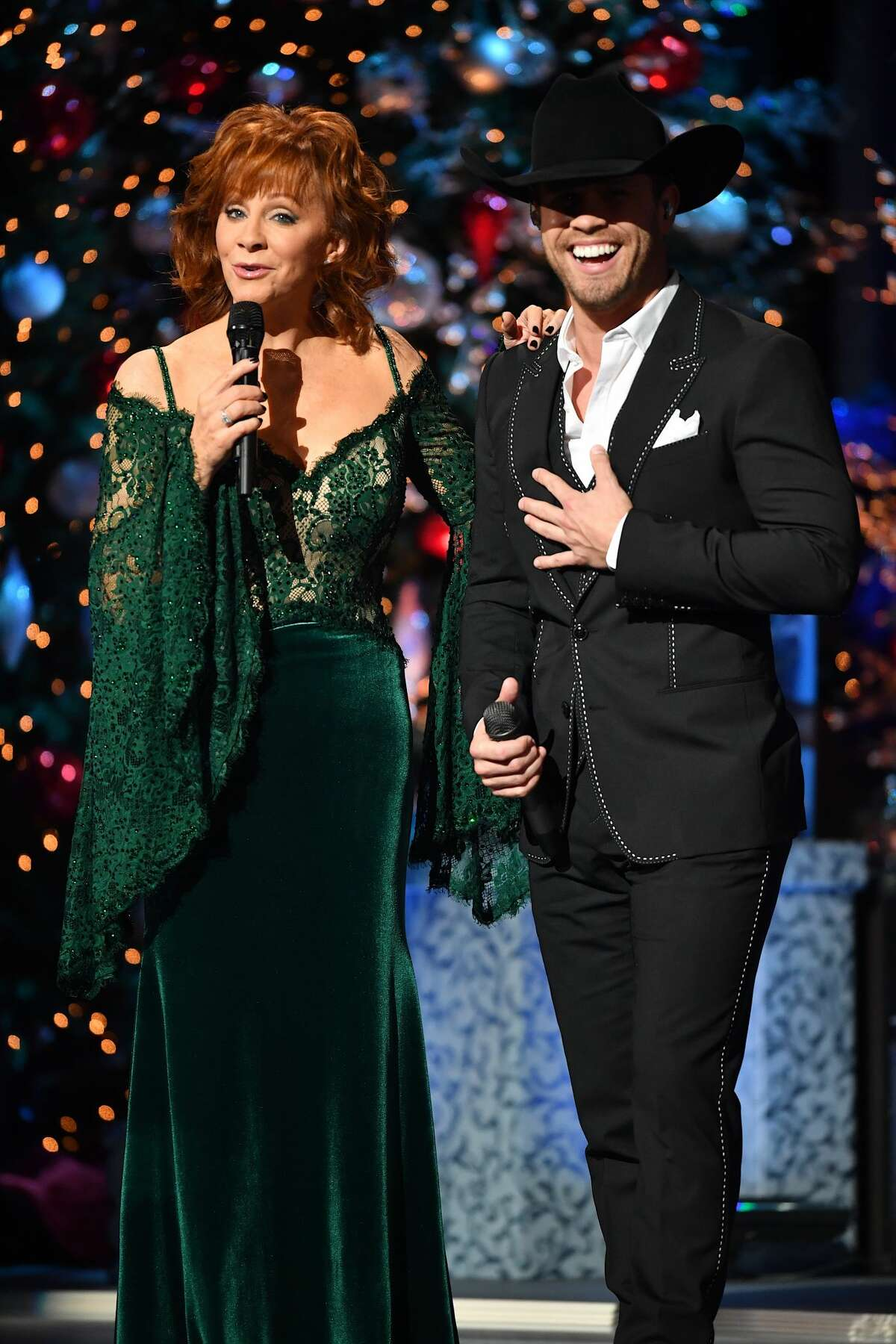 Recording Artists Reba McEntire and Dustin Lynch speak on stage during 2017 CMA Country Christmas at The Grand Ole Opry on November 14, 2017 in Nashville, Tennessee. (Photo by Jason Davis/WireImage)