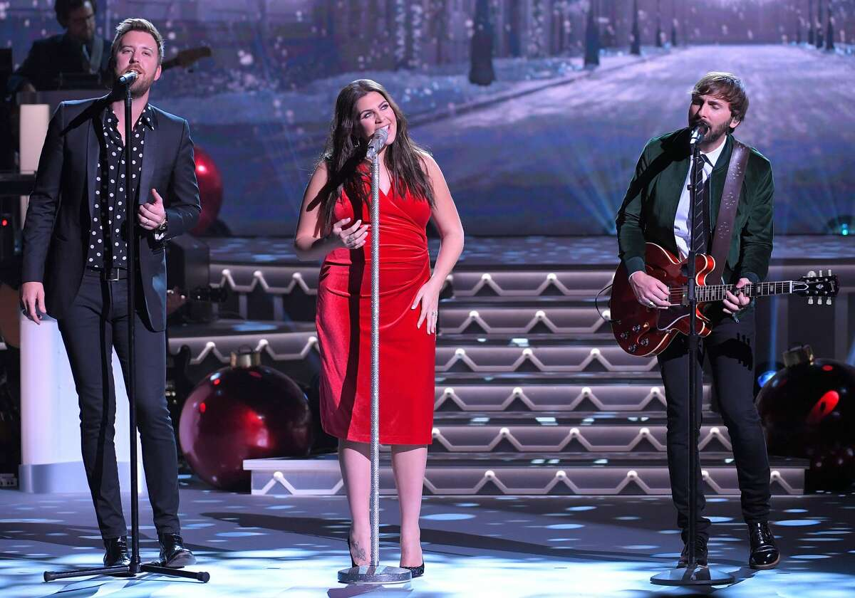 Recording artists Charles Kelly, Hillary Scott and Dave Haywood of Lady Antebellum perform during CMA 2017 Country Christmas at The Grand Ole Opry on November 14, 2017 in Nashville, Tennessee. (Photo by Mickey Bernal/FilmMagic)