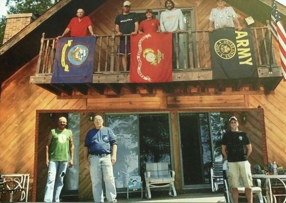 This shows the Seamster family at their family cottage on Wixom Lake as they gathered to celebrate the family being together. On the balcony, from left, are Wilbur (Navy) Chris, Ashley and Dick (Marines) and at the end is Dan McCallum (son-in-law, now deceased). On the ground floor, from left, are Jerry and Tom (Navy) and Blake (A Green Beret in Special Forces).