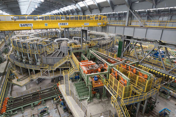 Tenaris' new $1.8 billion steel mill in Bay City commenced operations Wednesday to churn out steel piping for shale oil and gas wells.