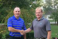 The Bad Axe Lions recently donated $5,000 from its annual golf outing to the Bad Axe Youth Soccer Organization to help with their fundraising efforts for the new pavilion they plan to build in the future.Pictured is (left) Sean McVey,Bad Axe Lions Golf Committee Chairman, andTimothy Geiger, member of the Bad Axe Youth Soccer Organization.(Submitted Photo)