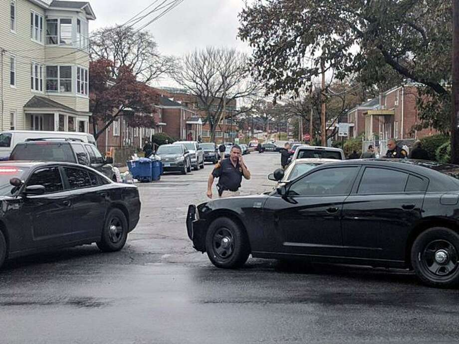 Pequonnock at Chestnut streets is closed on Thursday, Nov. 16, 2017 in Bridgeport because of the investigation. A suspect is in custody after a police said he shot at them. Schools along the route of the chase, along Pequonnock Street and Chestnut Street, were placed in lock-in, lock-out, including Geraldine Johnson Elementary and Columbus schools. Photo: Cedar Attanasion /Hearst Connecticut Media