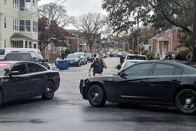 Pequonnock at Chestnut streets is closed on Thursday, Nov. 16, 2017 in Bridgeport because of the investigation. A suspect is in custody after a police said he shot at them. Schools along the route of the chase, along Pequonnock Street and Chestnut Street, were placed in lock-in, lock-out, including Geraldine Johnson Elementary and Columbus schools.