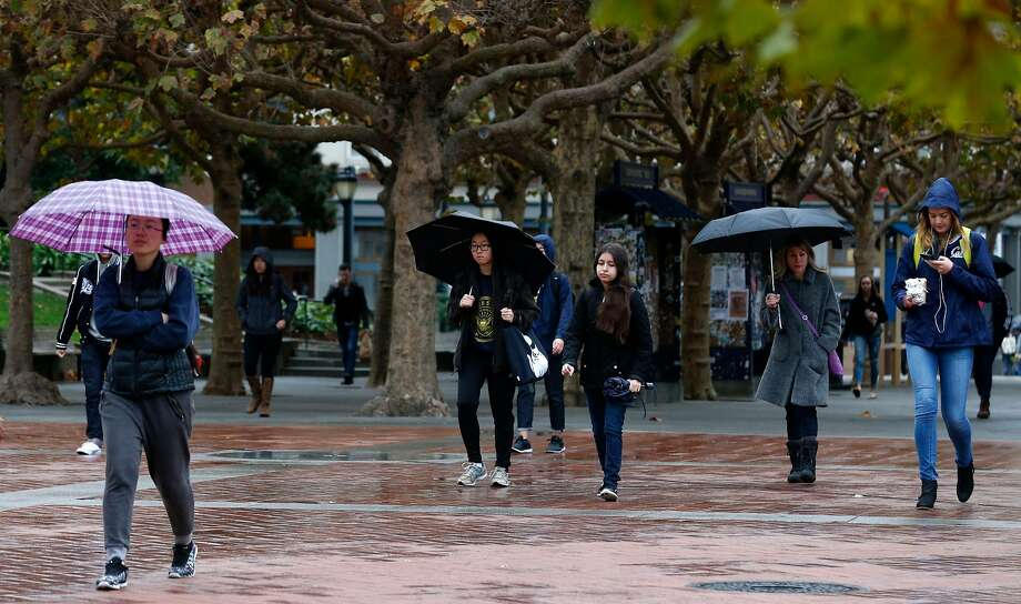 Students walk through Sproul Plaza during light rain at UC Berkeley on Wednesday, Nov. 15, 2017. Photo: Paul Chinn, The Chronicle