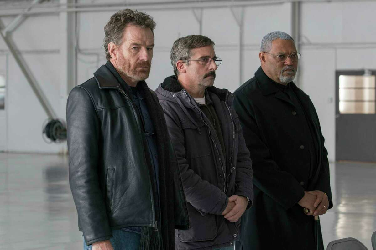 This image released by Lionsgate shows Bryan Cranston, from left, Steve Carrell and Laurence Fishburne in a scene from Last Flag Flying.