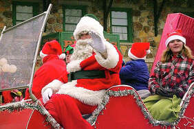 The Christmas Magic parade in Lake Ozarks culminates with a bonfire and caroling with Santa Claus.