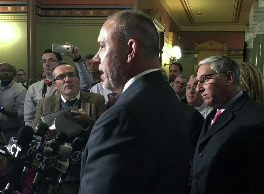 Connecticut Democratic House Speaker Joe Aresimowicz, left, and Republican Senate Leader Len Fasano, right, announce with other top legislative leaders that they had reached an agreement on a tentative framework for a new two-year budget, Wednesday, Oct. 18, 2017, at the Capitol in Hartford, Conn. Even after last month's budget deal, uncertainty still clouds Connecticut's economic outlook. Photo: Susan Haigh / Associated Press / Copyright 2017 The Associated Press. All rights reserved.