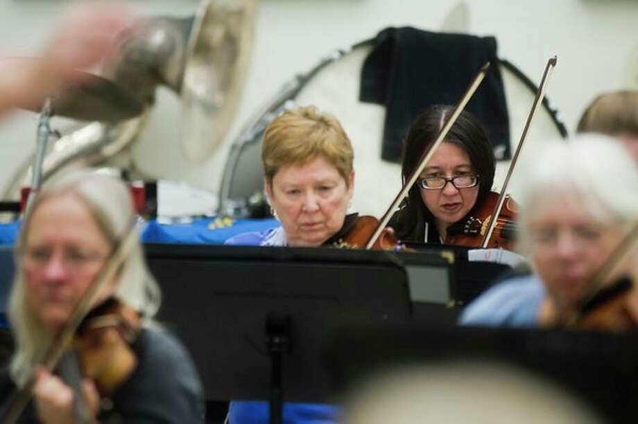 Members of the Midland Community Orchestra work on a piece during a rehearsal at Midland High School. (Katy Kildee/kkildee@mdn.net)