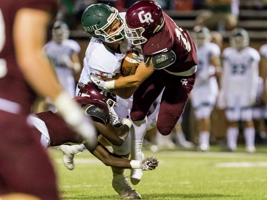 Strake Jesuit wide receiver Thomas Gordon (87) is tackled by Cinco Ranch defensive back Jamie Wolfe (21) in a high school football game at Rhodes Stadium on Friday, Sept. 29, 2017, in Katy, Texas. (Joe Buvid / For the Houston Chronicle) Photo: Joe Buvid, Freelance / © 2017 Joe Buvid