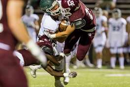 Strake Jesuit wide receiver Thomas Gordon (87) is tackled by Cinco Ranch defensive back Jamie Wolfe (21) in a high school football game at Rhodes Stadium on Friday, Sept. 29, 2017, in Katy, Texas. (Joe Buvid / For the Houston Chronicle)
