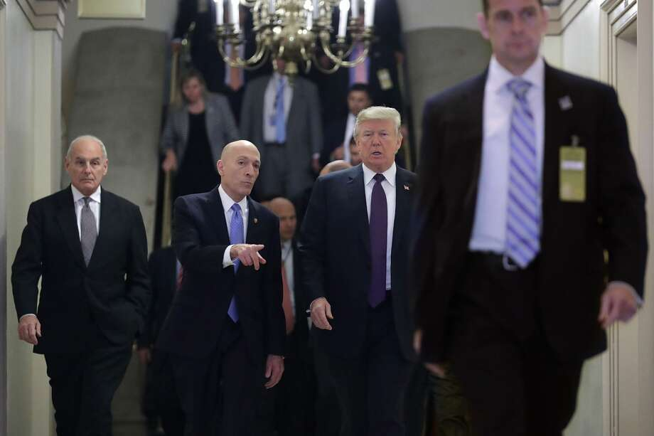 (L-R) White House Chief of Staff John Kelly,  House Sergeant at Arms Paul Irving and U.S. President Donald Trump arrive for a meeting with the House Republican conference at the U.S. Capitol November 16, 2017 in Washington, DC. Trump is huddling with House GOP members on the day they hope to pass tax reform legislation, moving the president one step closer to a promised tax cut for corporations and some individual Americans before the end of the year.  (Photo by Chip Somodevilla/Getty Images) Photo: Chip Somodevilla/Getty Images
