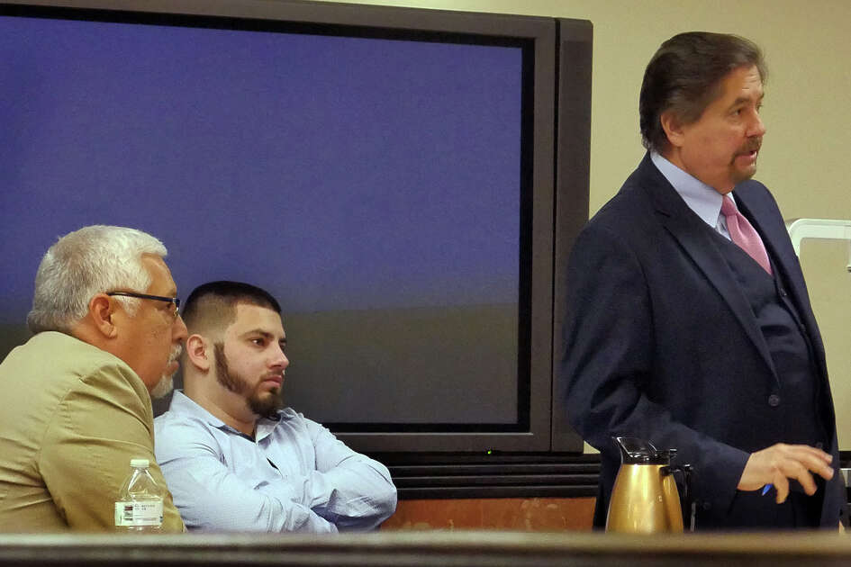 Alexis Guzman, center, who is charged with the murder of Antonio Gonzalez, sits with his defense attorneys in the 406th District Courtroom where he is on trial.
