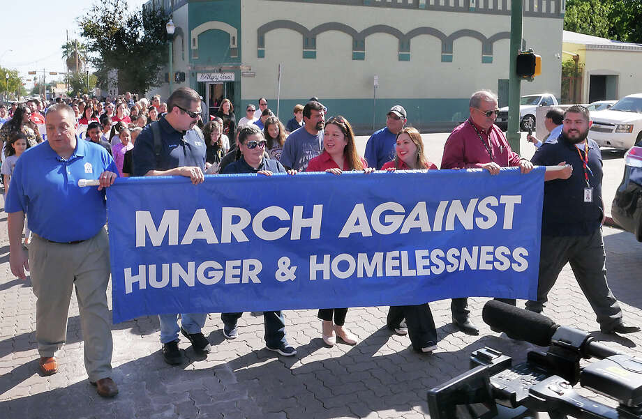 Representatives from different social service agencies participated in the 13th Annual March Against Hunger and Homelessness, Wednesday, November 15, 2017. The symbolic 8-block walk from Bethany House to San Agustin Cathedral was hosted by the Laredo Homeless Coalition. A traditional rice and beans lunch was served following the march. Photo: Cuate Santos/Laredo Morning Times