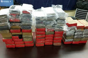 Over 219 pounds of powder cocaine was found during a traffic stop on Interstate 10 in Louisiana. The 80 bundles were found in luggage bags. The stash is estimated at $3 million. Photo: Calcasieu Parish Sheriff's Office