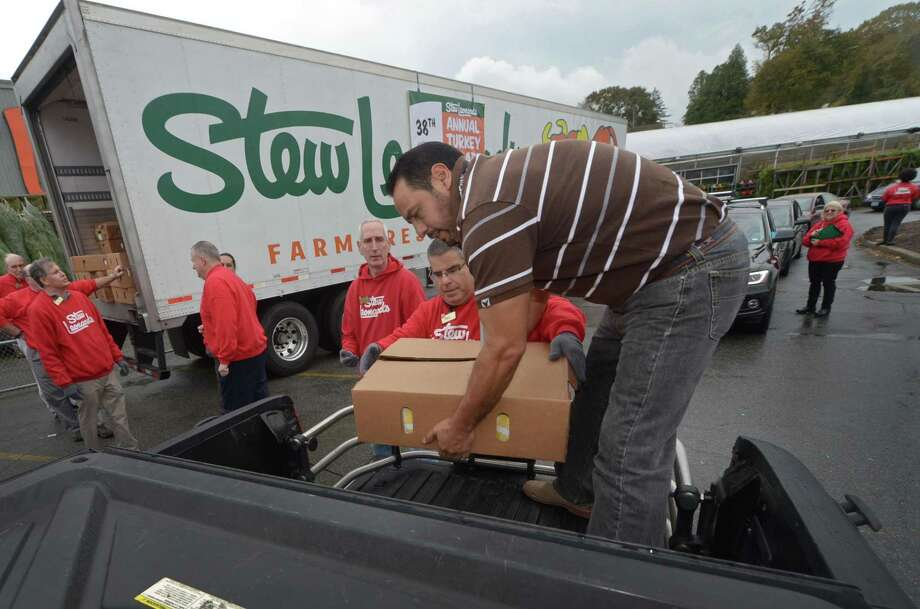 "Norwalk Community Health Center facilities manager Cesar Ramos receives cases of frozen turkeys as Stew Leonard's continues its long-standing tradition of giving thanks to the communities it serves with its 38th Annual ""Turkey Brigade"" Thursday, November 16, 2017, in Norwalk, Conn. The store gave away over 200 frozen turkeys to 33 organizations and over in Norwalk and 2,500 were distributed to more than 100 churches, civic groups, elderly housing and senior nutrition programs, and schools from all their stores in the Norwalk, Newington & Danbury, Connecticut and East Meadow, Farmingdale & Yonkers, New York. Photo: Erik Trautmann / Hearst Connecticut Media / Norwalk Hour"