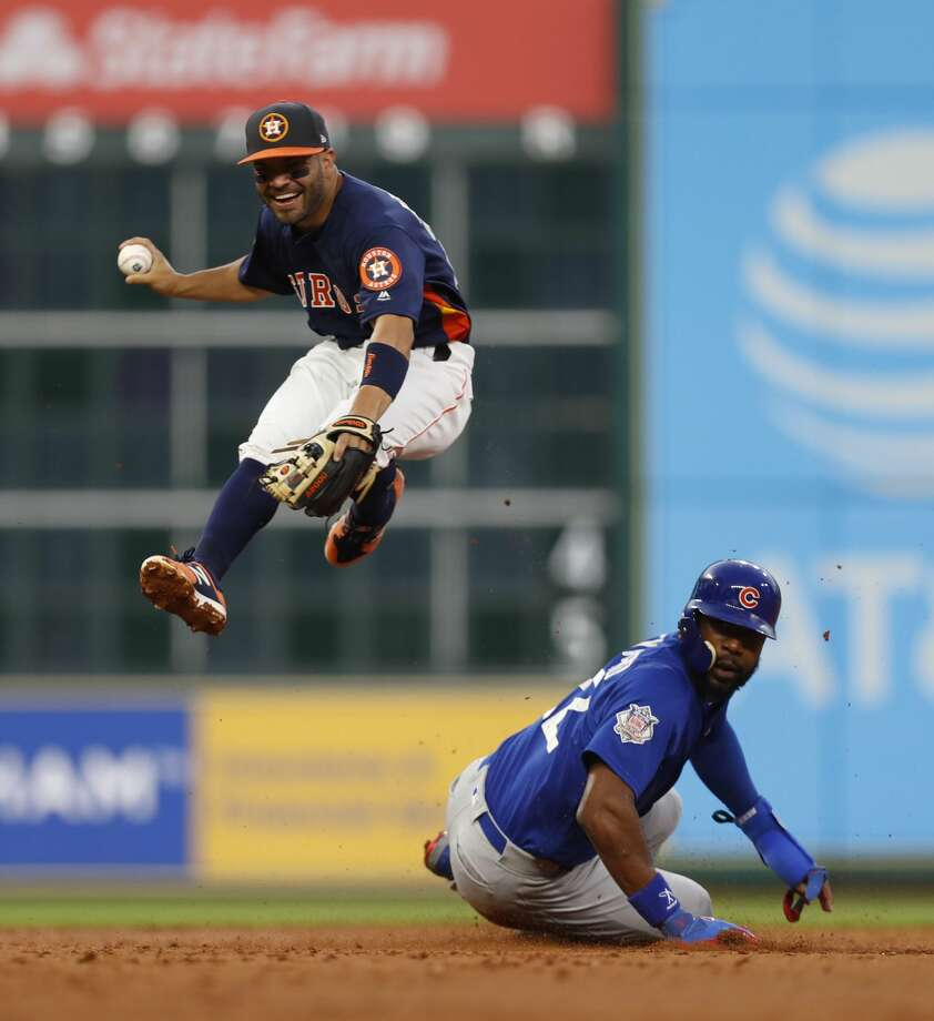 Houston Astros second baseman Jose Altuve (27) leaps over Chicago Cubs Jason Heyward (22) as Javier Baez grounded into a force out during the second inning of an MLB exhibition game at Minute Maid Park, Thursday, March 30, 2017, in Houston. Photo: Karen Warren/Houston Chronicle