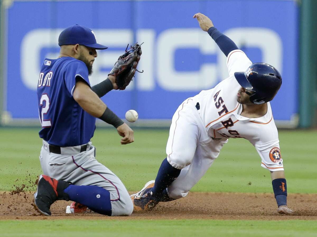 Houston Astros Jose Altuve steals second base against Texas Rangers Roughned Odor during the first inning at Minute Maid Park Monday, May 1, 2017, in Houston.